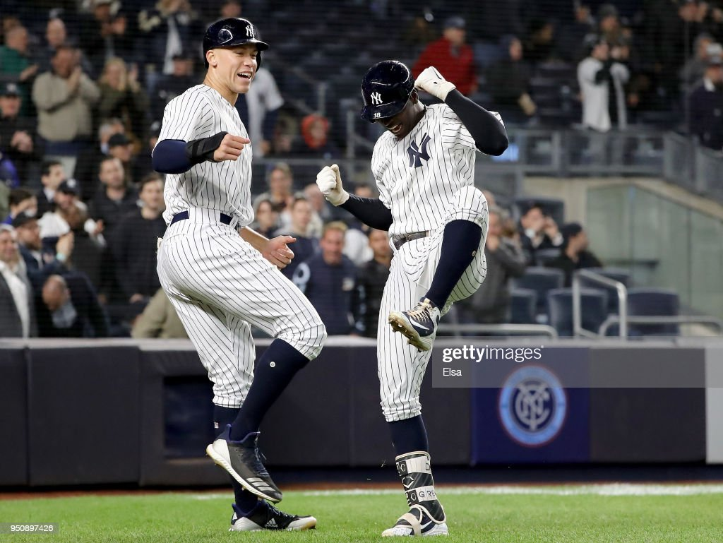 Aaron Judge #99 of the New York Yankees congratulates teammate Didi Gregorius #18 after he drove them both home with a home run in the fifth inning against the Minnesota Twins at Yankee Stadium on April 24, 2018 in the Bronx borough of New York City.