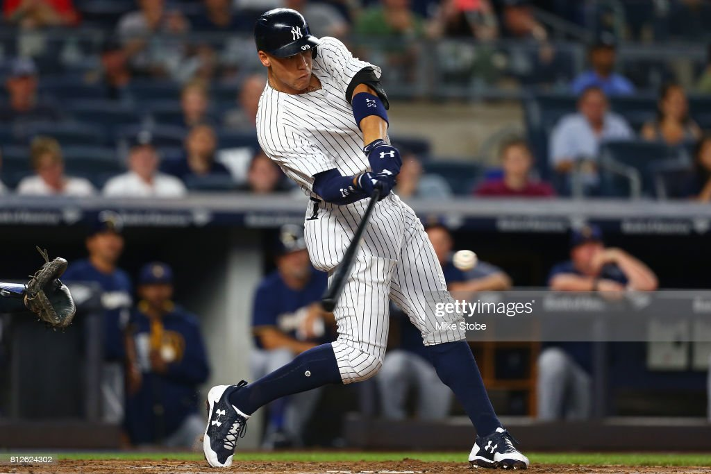 Aaron Judge #99 of the New York Yankees connect on a solo home run in the fifth inning against the Milwaukee Brewers at Yankee Stadium on July 7, 2017 in the Bronx borough of New York City.