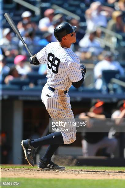 Aaron Judge of the New York Yankees connects on a 495 ft home run against the Baltimore Orioles at Yankee Stadium on June 11 2017 in the Bronx...