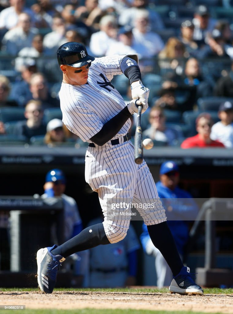 Aaron Judge #99 of the New York Yankees connects on a sixth inning RBI single against the Toronto Blue Jays at Yankee Stadium on April 21, 2018 in the Bronx borough of New York City.