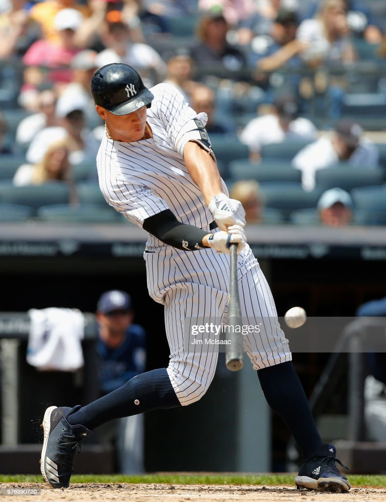 Aaron Judge #99 of the New York Yankees connects on a third inning double against the Tampa Bay Rays at Yankee Stadium on June 16, 2018 in the Bronx borough of New York City.