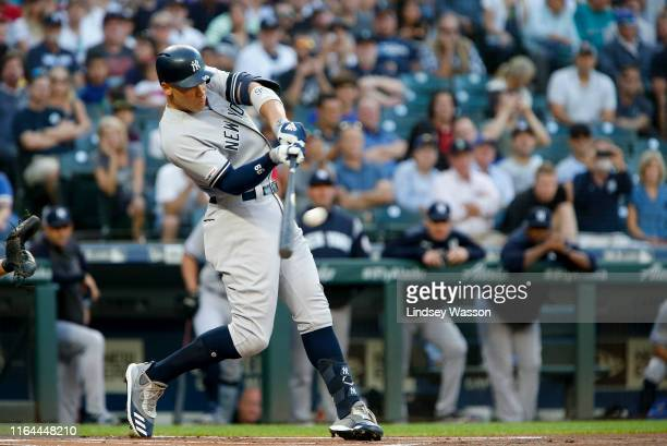 Aaron Judge of the New York Yankees connects with his 100th career home run in the first inning against the Seattle Mariners at TMobile Park on...