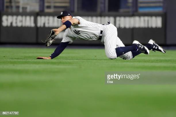 Aaron Judge of the New York Yankees dives and makes a catch against Cameron Maybin of the Houston Astros during the fifth inning in Game Three of the...