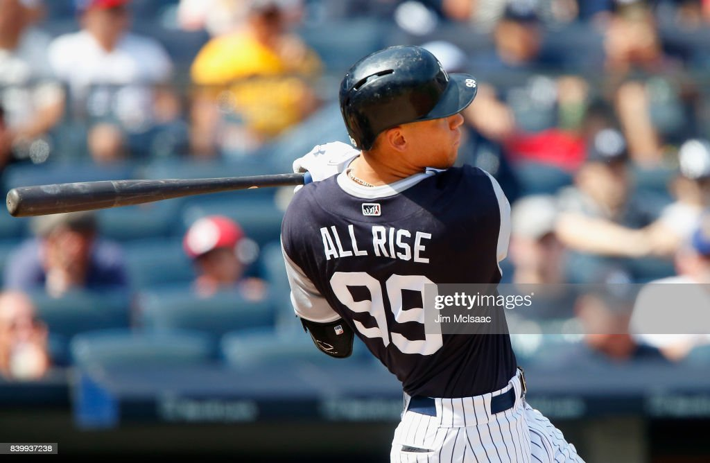 Aaron Judge #99 of the New York Yankees doubles in the fourth inning against the Seattle Mariners at Yankee Stadium on August 27, 2017 in the Bronx borough of New York City.