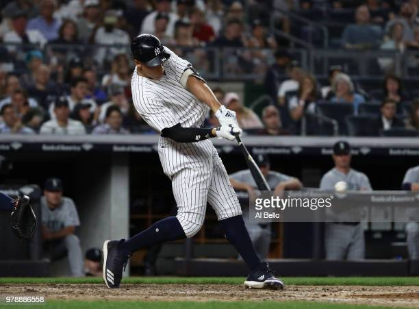 Aaron Judge of the New York Yankees drives in a run in the seventh inning against the Seattle Mariners during their game at Yankee Stadium on June 19...