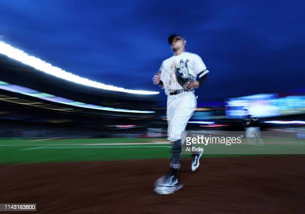 Aaron Judge of the New York Yankees enters the dugout between innings against the Boston Red Sox during their game at Yankee Stadium on April 16 2019...