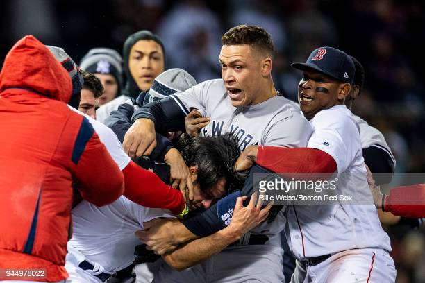 Aaron Judge of the New York Yankees fights with Joe Kelly of the Boston Red Sox after Tyler Austin was hit by a pitch during the seventh inning of a...