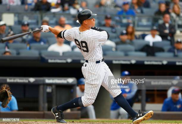 Aaron Judge of the New York Yankees follow through on a fourth inning home run against the Toronto Blue Jays at Yankee Stadium on September 30 2017...