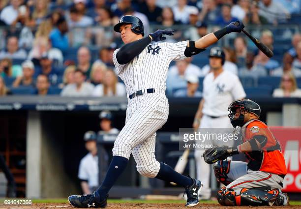 Aaron Judge of the New York Yankees follows through on a first inning home run against the Baltimore Orioles at Yankee Stadium on June 10 2017 in the...