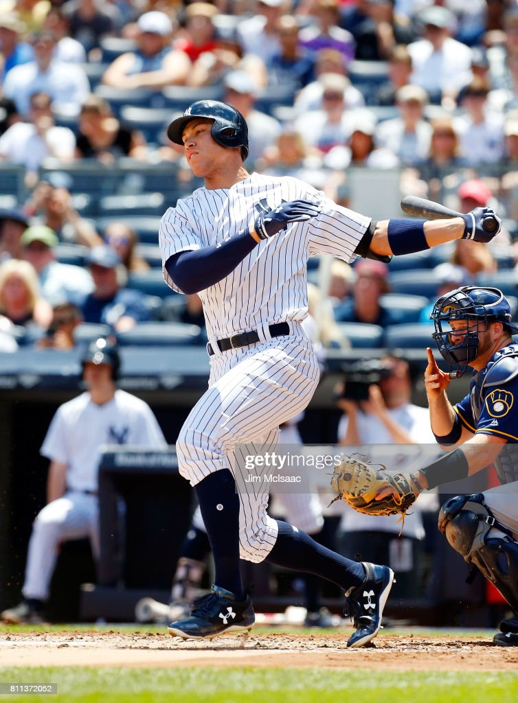 Aaron Judge #99 of the New York Yankees follows through on a first inning infield base hit against the Milwaukee Brewers at Yankee Stadium on July 9, 2017 in the Bronx borough of New York City.