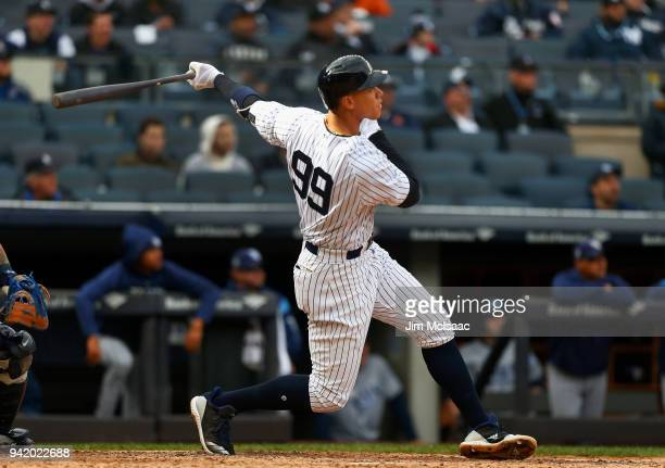 Aaron Judge of the New York Yankees follows through on a fourth inning two run home run against the Tampa Bay Rays at Yankee Stadium on April 4 2018...