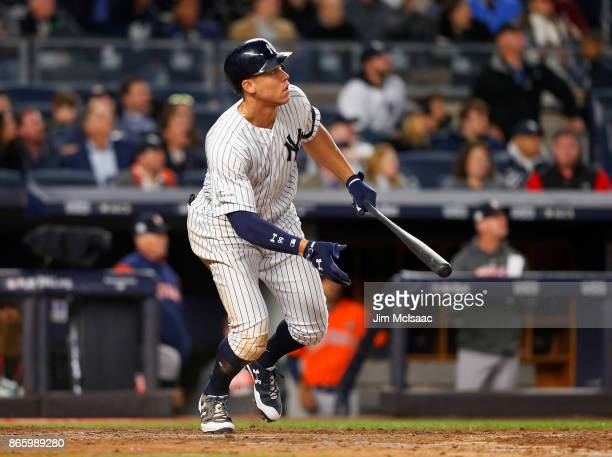 Aaron Judge of the New York Yankees follows through on a seventh inning home run against the Houston Astros in Game Four of the American League...