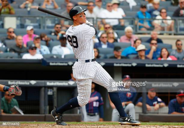 Aaron Judge of the New York Yankees follows through on a third inning home run against the Minnesota Twins at Yankee Stadium on September 20 2017 in...