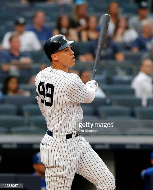 Aaron Judge of the New York Yankees follows through on his first inning home run against the Toronto Blue Jays at Yankee Stadium on June 25 2019 in...