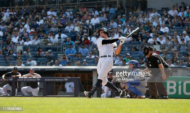 Aaron Judge of the New York Yankees follows through on his first inning home run against the Toronto Blue Jays at Yankee Stadium on September 22 2019...