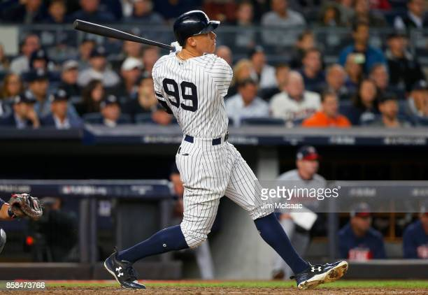Aaron Judge of the New York Yankees follows through on his fourth inning two run home run against the Minnesota Twins in the American League Wild...