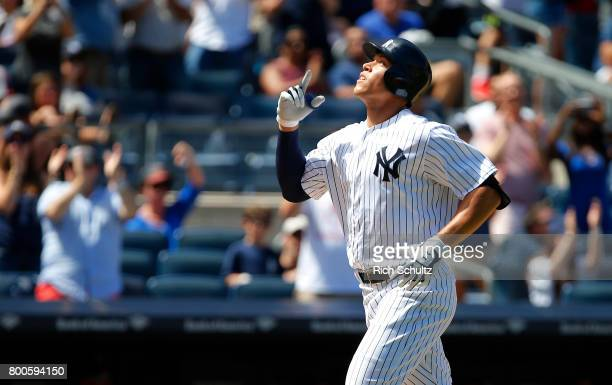 Aaron Judge of the New York Yankees gestures after he hit a home run against the Texas Rangers during the sixth inning of a game at Yankee Stadium on...