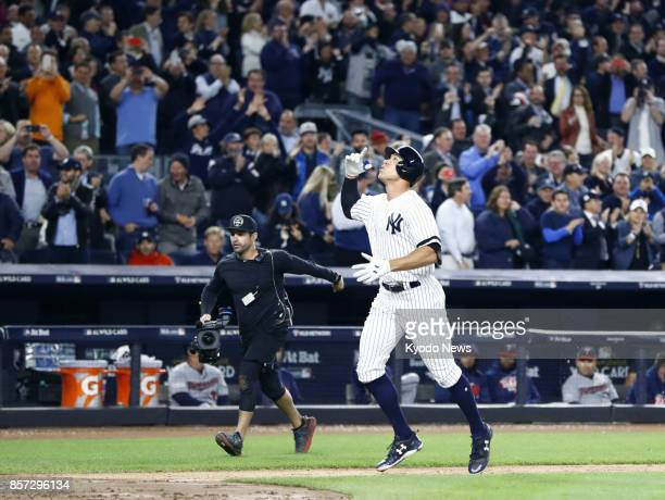Aaron Judge of the New York Yankees gestures as he crosses home plate after hitting a tworun home run in the fourth inning of the American League...