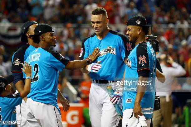 Aaron Judge of the New York Yankees gets congratulated by teammates during the 2017 TMobile Home Run Derby at Marlins Park on Monday July 10 2017 in...