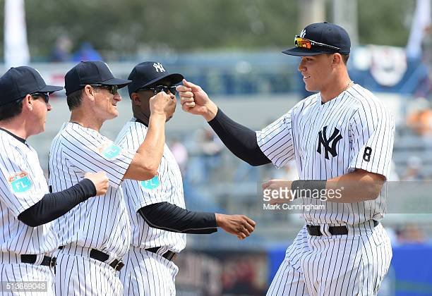 Aaron Judge of the New York Yankees gets highfives from coaches prior to the Spring Training game against the Detroit Tigers at George M Steinbrenner...