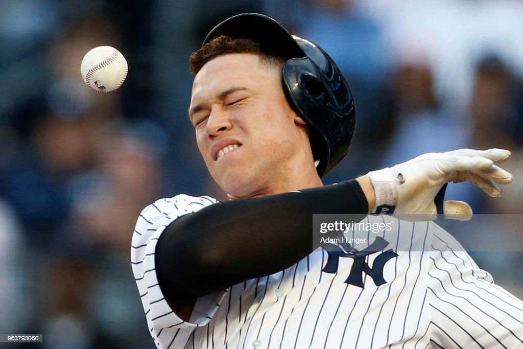 Aaron Judge #99 of the New York Yankees has his batting helmet knocked off by a foul ball during the third inning against the Houston Astros at Yankee Stadium on May 30, 2018 in the Bronx borough of New York City.