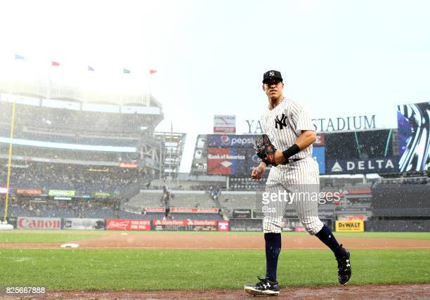 Aaron Judge of the New York Yankees heads for the dugout as a rain delay before the start of the eighth inning against the Detroit Tigers on August 2...