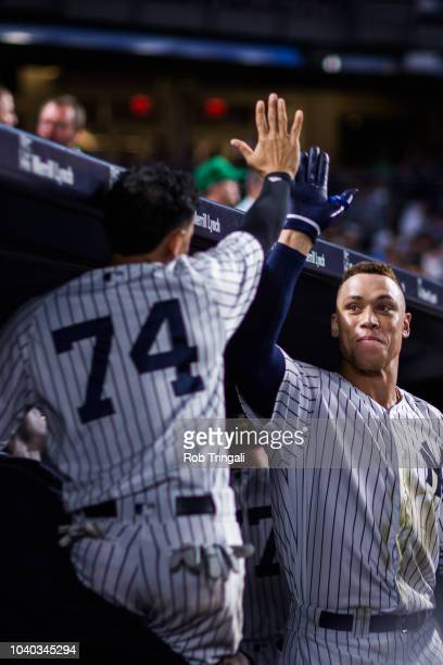 Aaron Judge of the New York Yankees hifives Ronald Torreyes after hitting a home run in the fifth inning during the game against the Detroit Tigers...