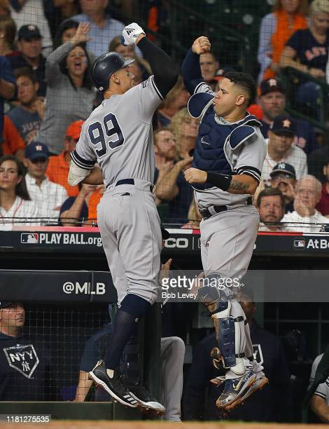 Aaron Judge of the New York Yankees high fives Gary Sanchez after hitting a home run in the fourth inning against the Houston Astros during game two...