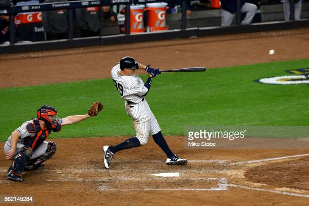 Aaron Judge of the New York Yankees hits a 3-run home run during the fourth inning against the Houston Astros in Game Three of the American League...