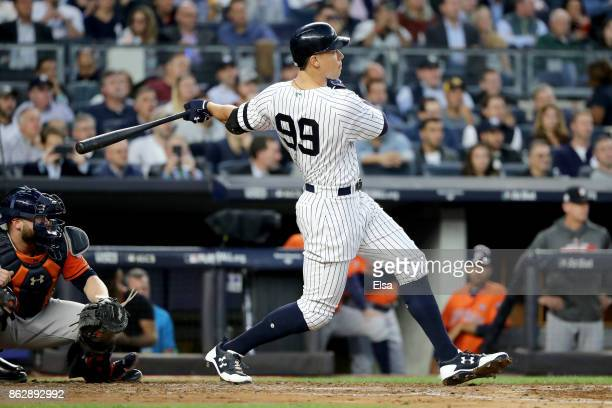 Aaron Judge of the New York Yankees hits a double during the third inning scoring Brett Gardner against the Houston Astros in Game Five of the...