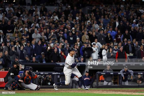 Aaron Judge of the New York Yankees hits a double in the eighth inning against the Houston Astros during Game Four of the American League...