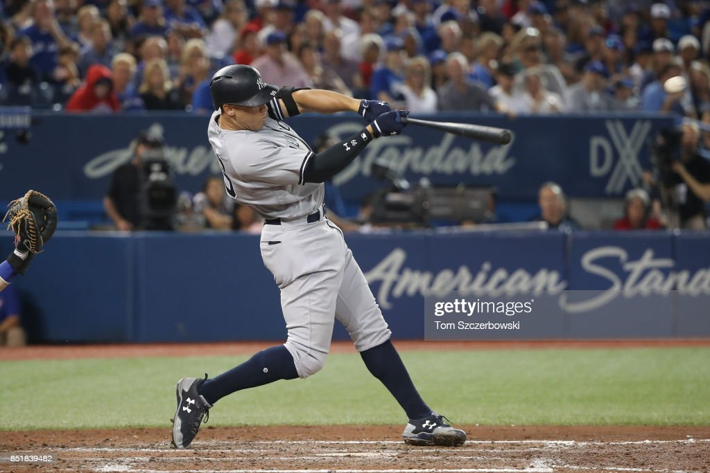 Aaron Judge #99 of the New York Yankees hits a double in the sixth inning during MLB game action against the Toronto Blue Jays at Rogers Centre on September 22, 2017 in Toronto, Canada.