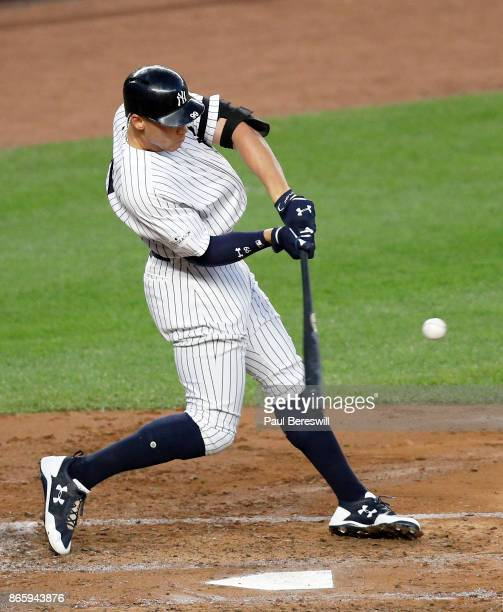 Aaron Judge of the New York Yankees hits a double to drive in Brett Gardner in the third inning of game 5 of the American League Championship Series...
