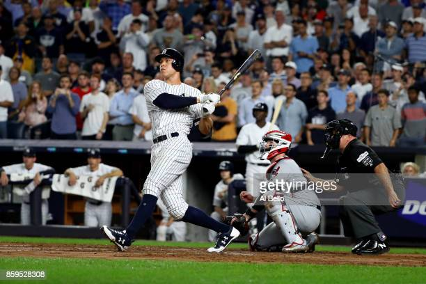 Aaron Judge of the New York Yankees hits a double to left field to score Brett Gardner and Aaron Hicks against Trevor Bauer of the Cleveland Indians...