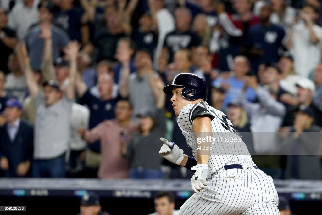Aaron Judge #99 of the New York Yankees hits a double to left field to score Brett Gardner #11 and Aaron Hicks #31 against Trevor Bauer #47 of the Cleveland Indians during the second inning in Game Four of the American League Divisional Series at Yankee Stadium on October 9, 2017 in the Bronx borough of New York City.