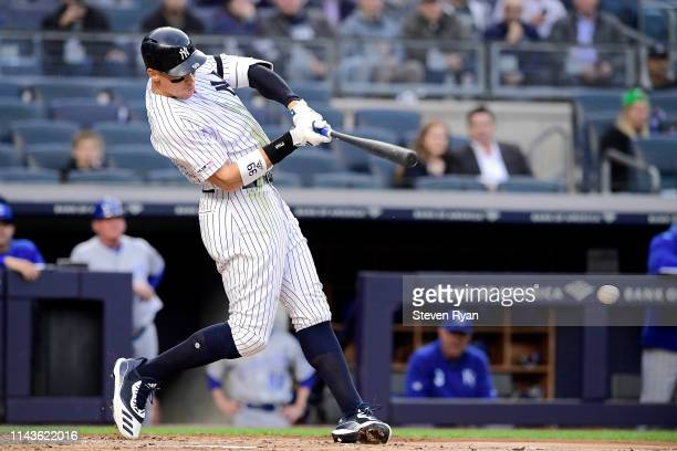 Aaron Judge of the New York Yankees hits a firstinning single against the Kansas City Royals at Yankee Stadium on April 18 2019 in New York City