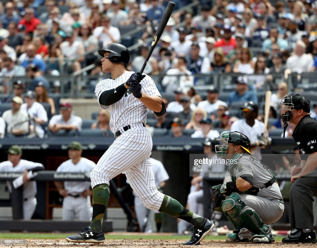Aaron Judge #99 of the New York Yankees hits a grand slam in the third inning as Josh Phegley #19 of the Oakland Athletics defends on May 28, 2017 at Yankee Stadium in the Bronx borough of New York City.