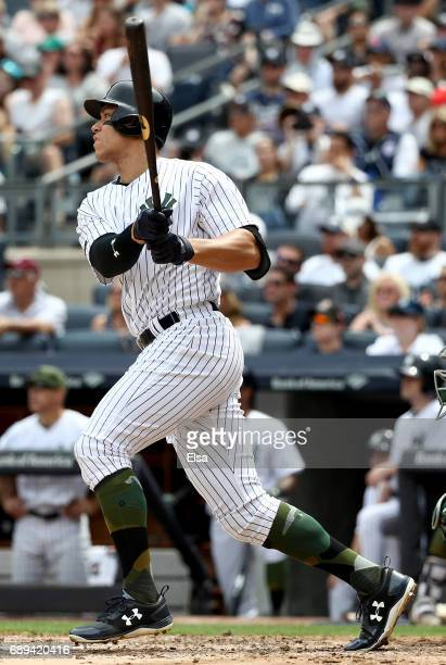 Aaron Judge of the New York Yankees hits a grand slam in the third inning against the Oakland Athletics on May 28 2017 at Yankee Stadium in the Bronx...