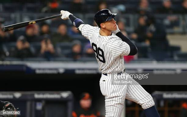 Aaron Judge of the New York Yankees hits a home run against the Baltimore Orioles during the sixth inning of a game at Yankee Stadium on April 5 2018...