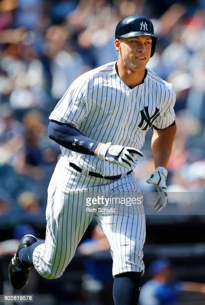 Aaron Judge of the New York Yankees hits a home run against the Texas Rangers during the sixth inning of a game at Yankee Stadium on June 24 2017 in...