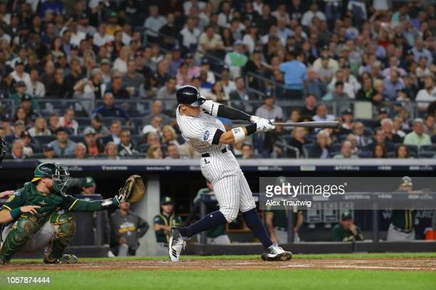 Aaron Judge of the New York Yankees hits a home run during the American League Wild Card game against the Oakland Athletics at Yankee Stadium on...