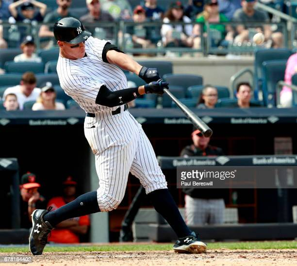 Aaron Judge of the New York Yankees hits a home run in an MLB baseball game against the Baltimore Orioles on April 29 2017 at Yankee Stadium in the...
