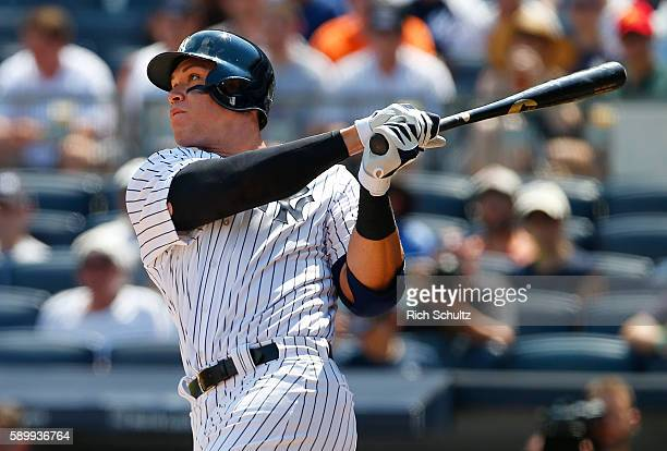 Aaron Judge of the New York Yankees hits a home run in his first MLB at bat during the second inning of a game against the Tampa Bay Rays at Yankee...