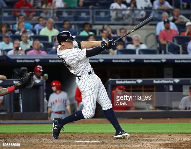 Aaron Judge of the New York Yankees hits a home run in the fifth inning against the Los Angeles Angels during their game at Yankee Stadium on June 20...
