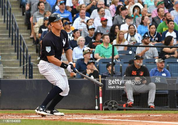 Aaron Judge of the New York Yankees hits a homerun in the first inning during the spring training game against the Baltimore Orioles at Steinbrenner...