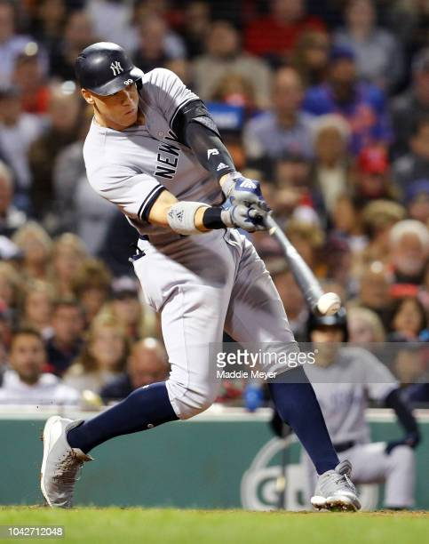 Aaron Judge of the New York Yankees hits a single during the fourth inning against the Boston Red Sox at Fenway Park on September 28 2018 in Boston...