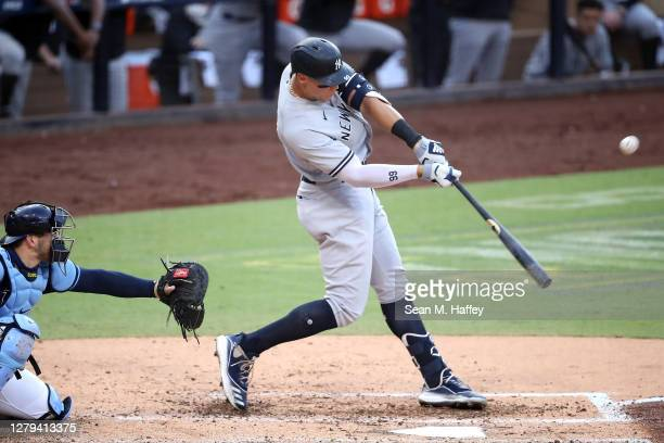 Aaron Judge of the New York Yankees hits a solo home run against the Tampa Bay Rays during the fourth inning in Game Five of the American League...