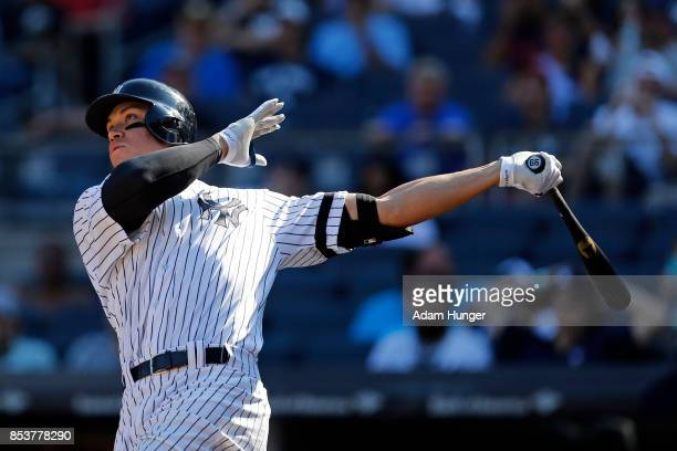 Aaron Judge of the New York Yankees hits a solo home run against the Kansas City Royals during the seventh inning at Yankee Stadium on September 25...