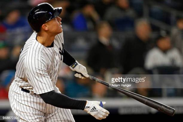 Aaron Judge of the New York Yankees hits a solo home run against the Toronto Blue Jays during the seventh inning at Yankee Stadium on April 19 2018...