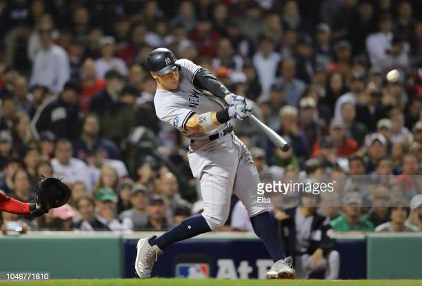 Aaron Judge of the New York Yankees hits a solo home run during the first inning of Game Two of the American League Division Series against the...